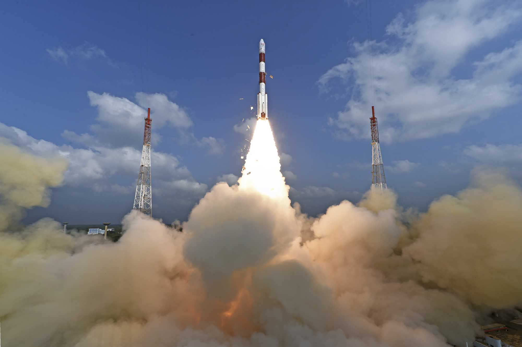 This photograph released by Indian Space Research Organization shows its polar satellite launch vehicle lifting off from a launch pad at the Satish Dhawan Space Centre in India, Wednesday, Feb.15, 2017. [Photo: Indian Space Research Organization via AP]