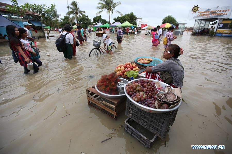 People affected by flooding in Yangon, Myanmar