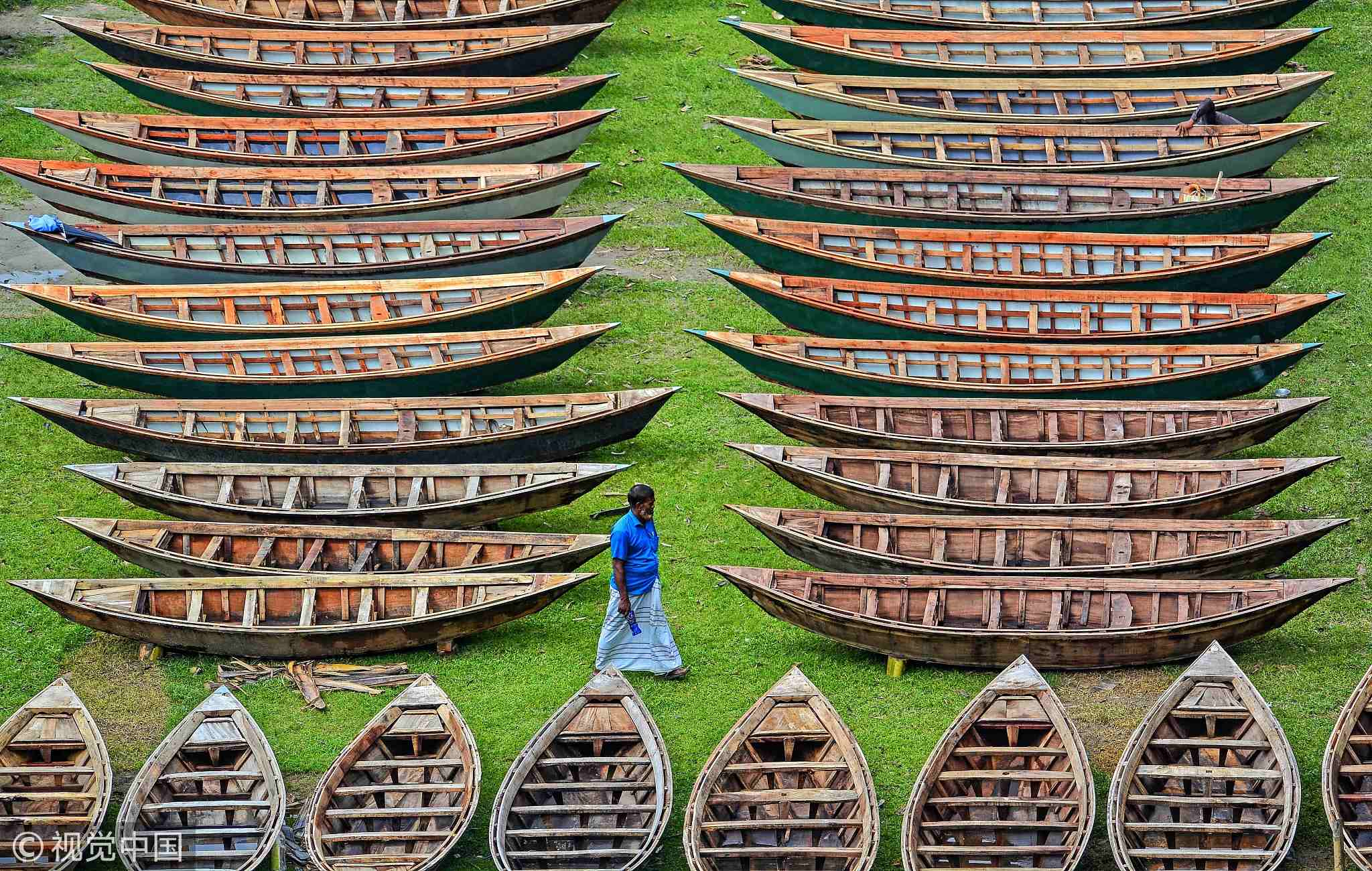 Hundreds of wooden boats are prepared for rainy season in Bangladesh