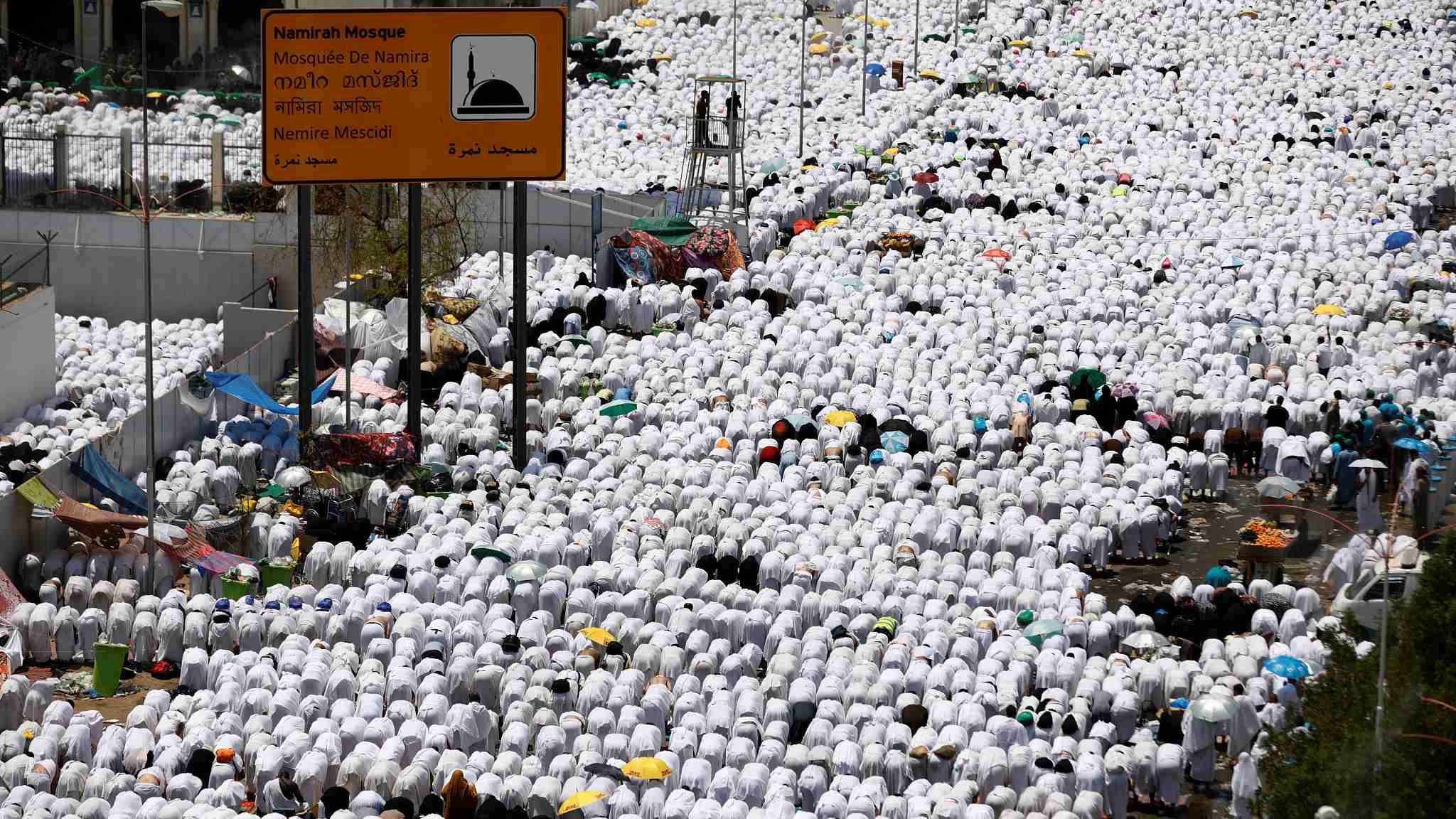 Muslim pilgrims gather on Mount Arafat for Hajj pilgrimage in Saudi Arabia