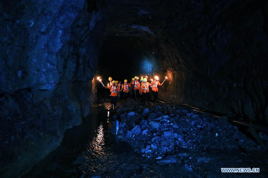 Workers patrol tunnel to ensure railway safety during flood season in SW China's Guizhou
