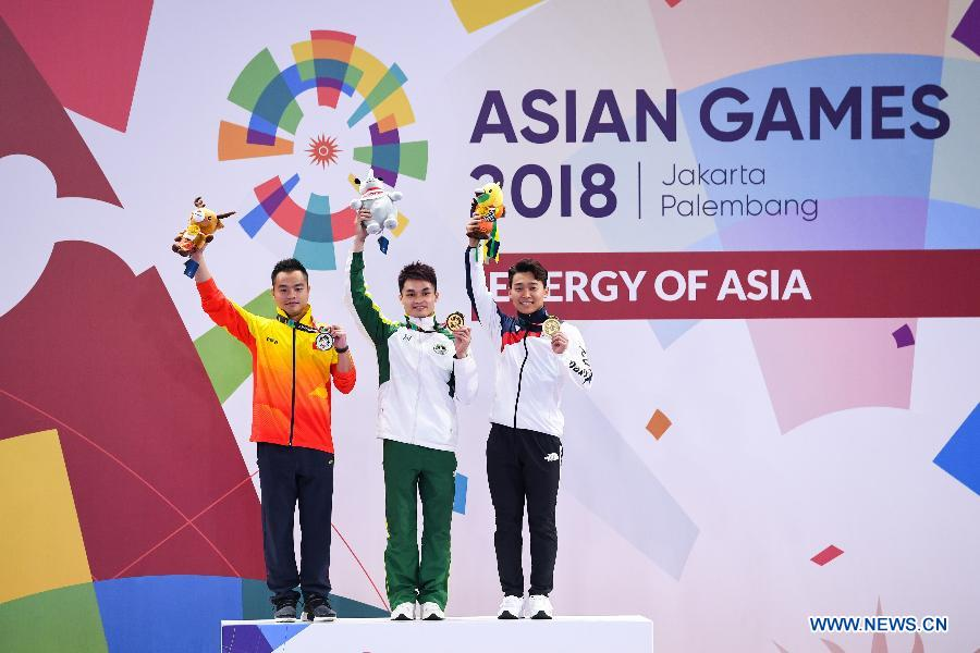 Huang Junhua wins Men's Nanquan & Nangun All-Round match at 18th Asian Games