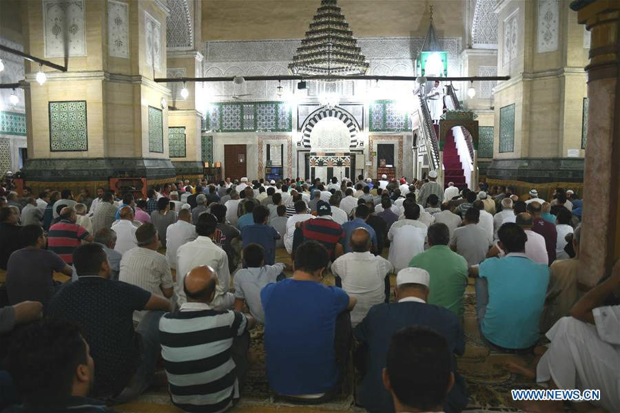 Muslims pray during Eid al-Adha celebration in Tunis