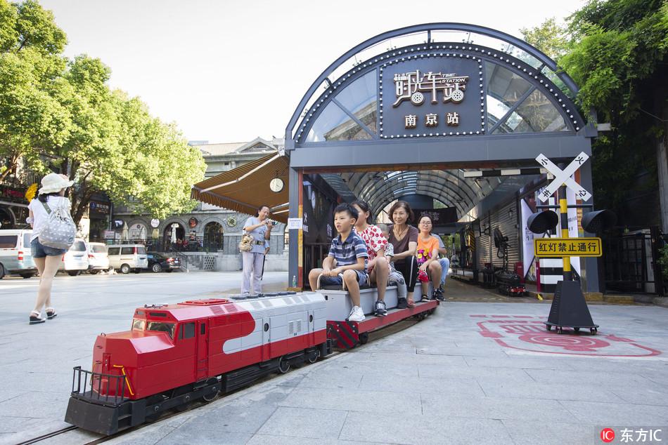 Mini train rolls along Nanjing street