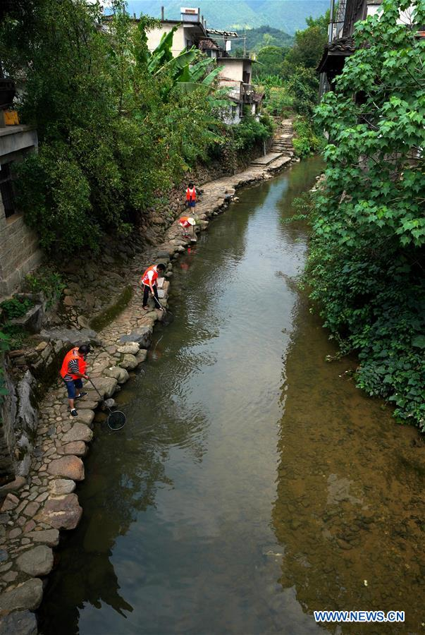 Three provinces of China make efforts to clean up water in tri-border area