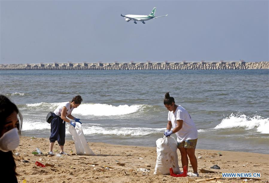 Lebanese environmental activists clean beach at south of Beirut