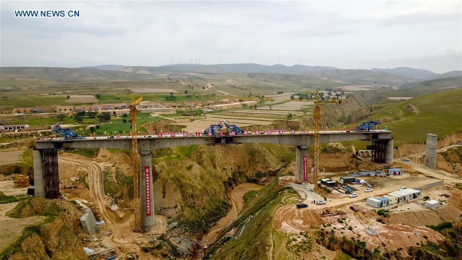 Workers join together girders of Mafanggou bridge of Yinchuan-Xi'an high-speed railway in NW China's Ningxia