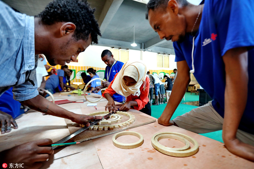Staff from Africa work in a factory. [File Photo: IC]