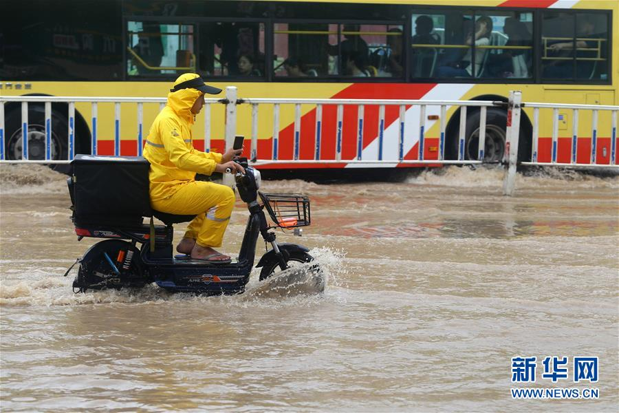 Torrential rains flood cities in SE China