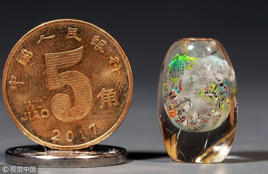 Artist paints 167 birds inside coin-sized snuff bottle