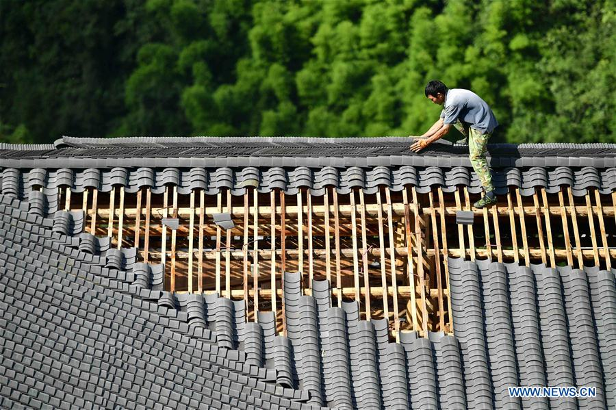 Residence compound with ethnic features built to boost local tourism in China's Hubei