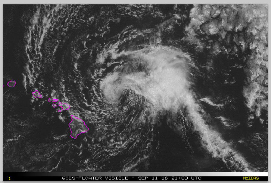 This satellite image made available the National Oceanic and Atmospheric Administration (NOAA) shows Tropical Storm Olivia east of the main islands of Hawaii at 11 a.m. Hawaii time Tuesday, Sept. 11, 2018. Central Pacific Hurricane Center meteorologist Matthew Foster says the storm could deposit 10 to 15 inches of rain on the islands, though some areas could get as much as 20 inches. [Photo: NOAA via AP]