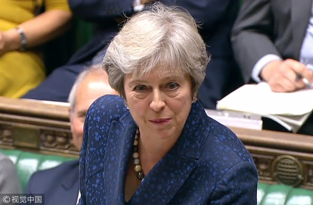 A video grab from footage broadcast by the UK Parliament's Parliamentary Recording Unit (PRU) shows Britain's Prime Minister Theresa May address MPs during the weekly Prime Minister's Questions (PMQs) in the House of Commons in London on September 12, 2018. [Photo: VCG]