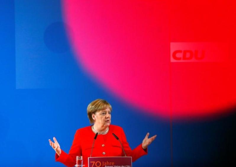 Merkel calls for more German military spending, but SPD eyes tax cuts