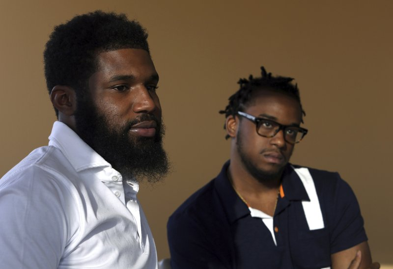Black men arrested at Starbucks settle with city, company