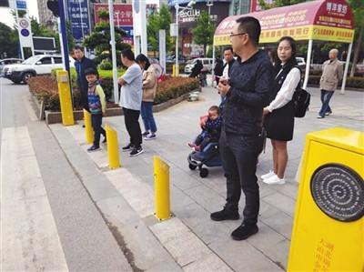 City installs water-spraying poles to stop pedestrian traffic violations