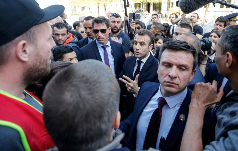 Macron faces spreading student protests, rail strikes