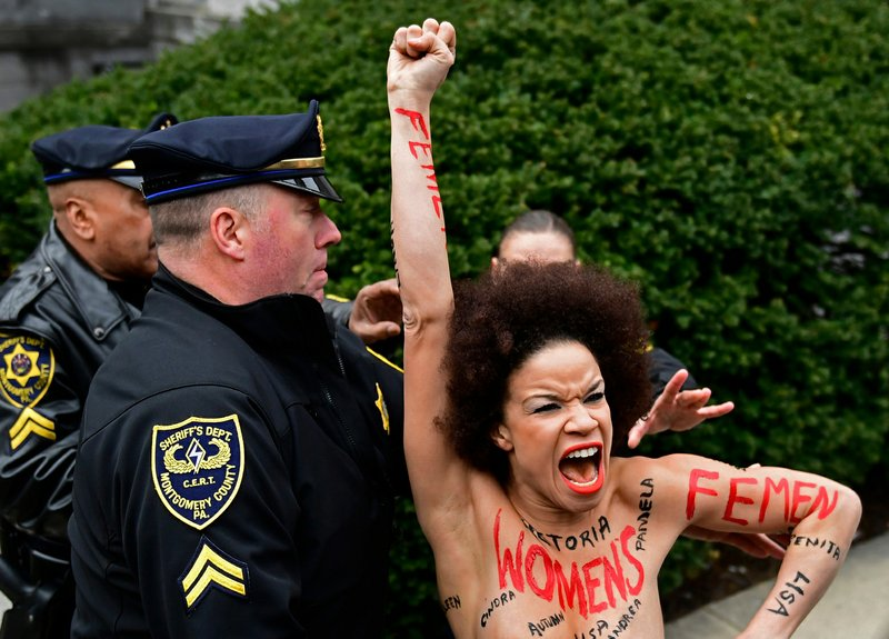 Topless protester: 'Goal was to make Cosby uncomfortable'
