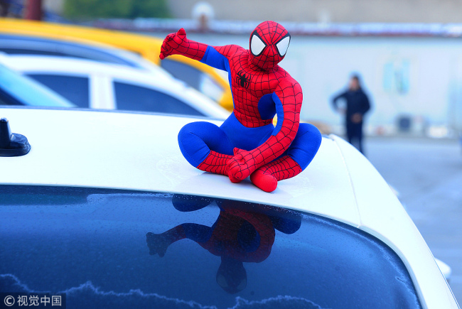 Chengdu police say 'no' to 'superheroes' on car roof