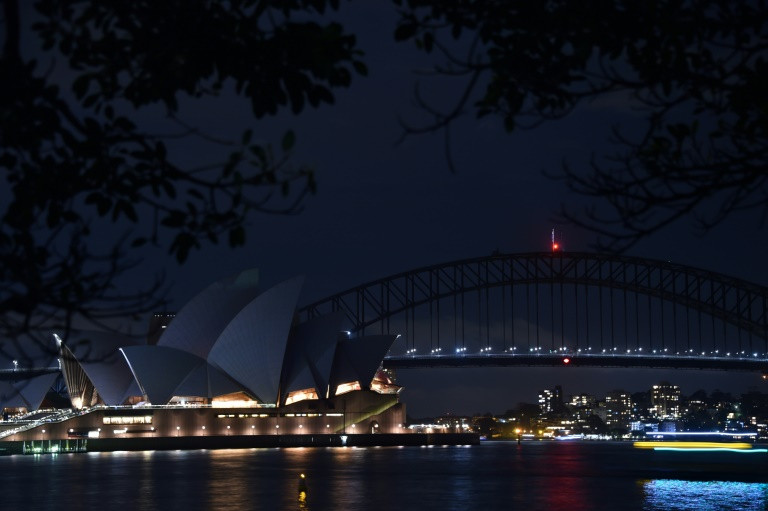 World cities go dark as Earth Hour climate campaign circles globe