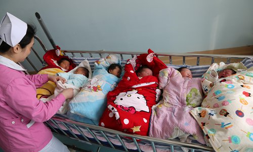 Latest population data prompts call for China's family planning policy to be abolished