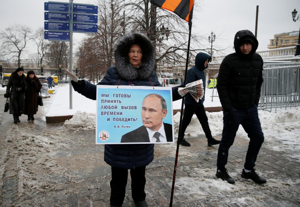 Putin rides 'Russia First' wave toward election victory