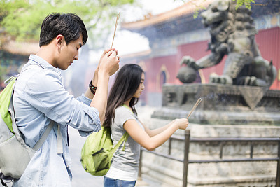 Chinese youth adopt 'Buddha-like' mindset in face of modern pressures