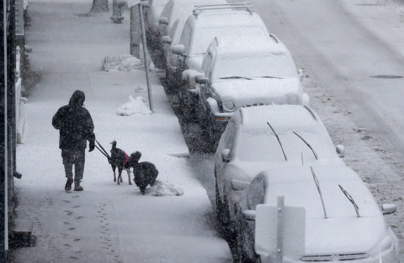 Nor'easter, blizzard conditions sock winter-weary Northeast