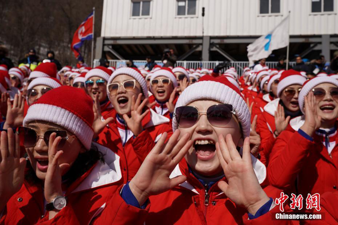 North Korean cheer squad cheers for alpine skiers