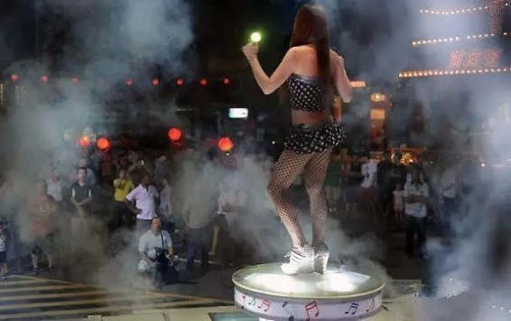China vows to crack down on rural custom of hiring strippers for funerals