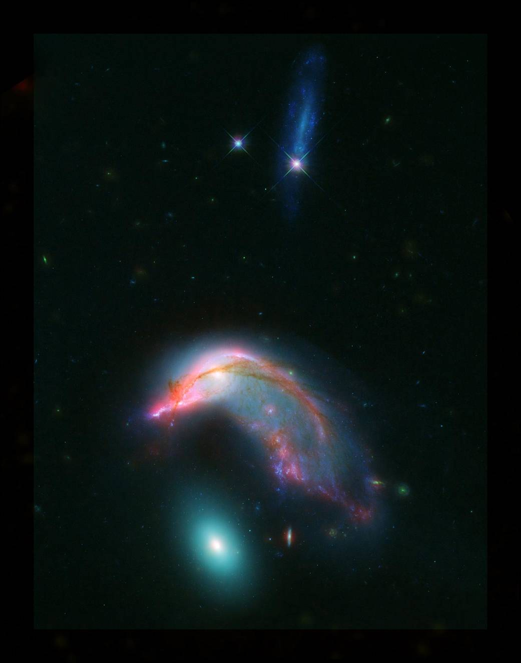 NASA shows off the strange 'Penguin and Egg' twin galaxies
