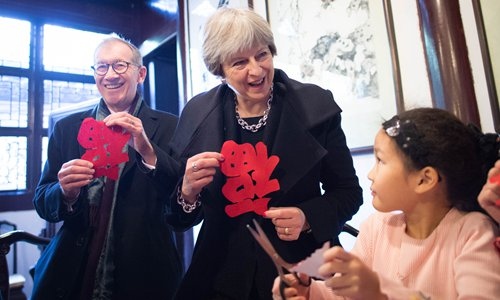 May promises to open new chapter