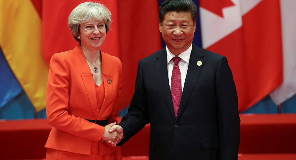Chinese President Xi Jinping (R) shakes hands with Britain's Prime Minister Theresa May during the G20 Summit in Hangzhou, Zhejiang province, China September 4, 2016.