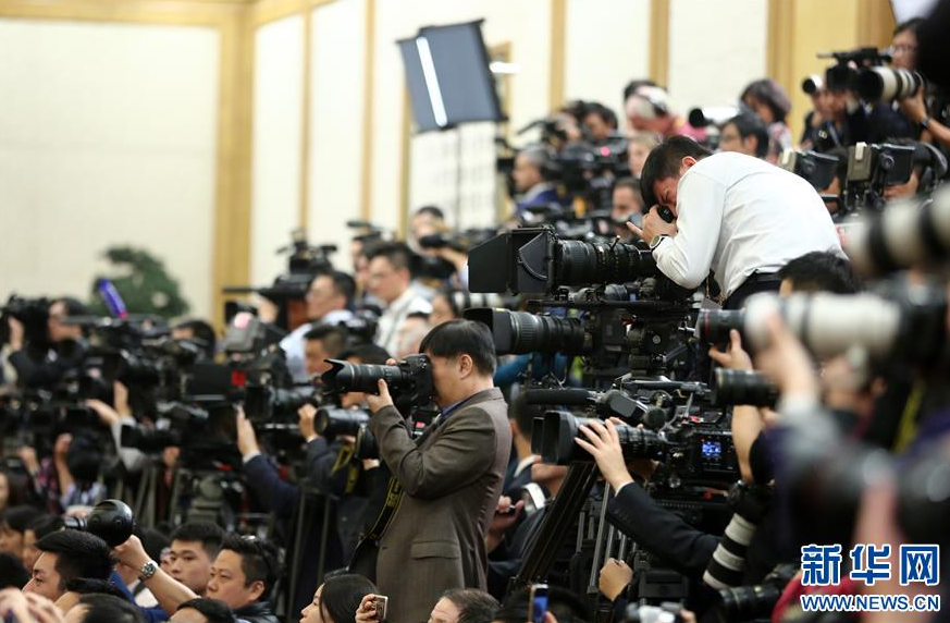 China invites reporters to cover political meetings