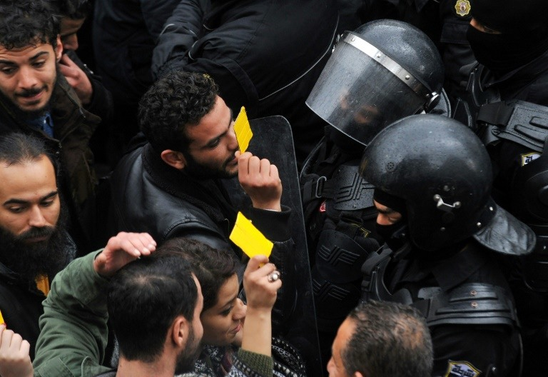 Scuffles as Tunisia protesters wave yellow cards at government