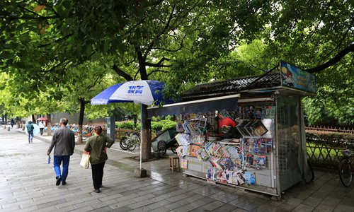 Vendors lament end of era as cities order removal of news stands