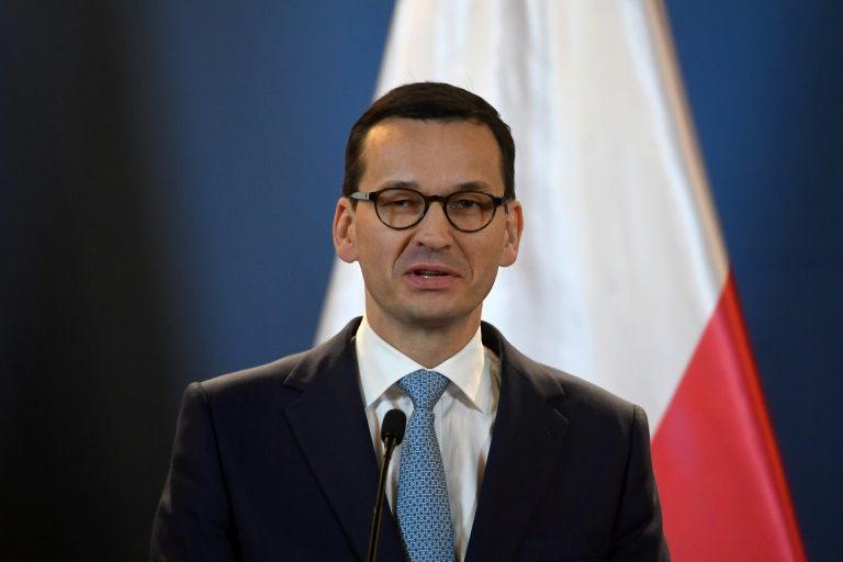 Polish PM sacks key ministers in move to mend EU ties