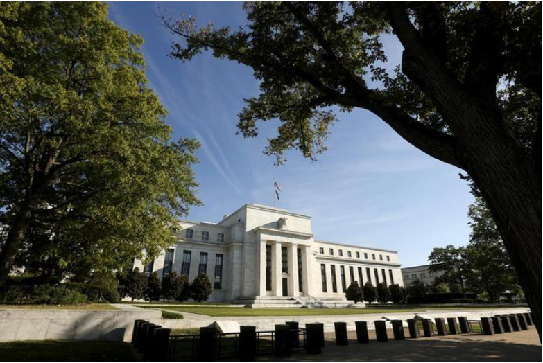 Fed policymakers see future rate rises guided by inflation, fiscal stimulus