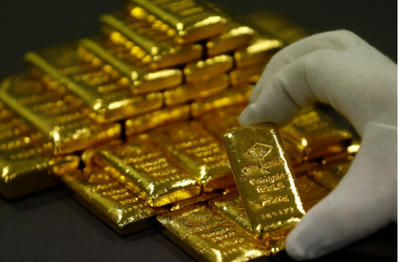 Gold soars toward largest annual gain since 2010 on dollar boost