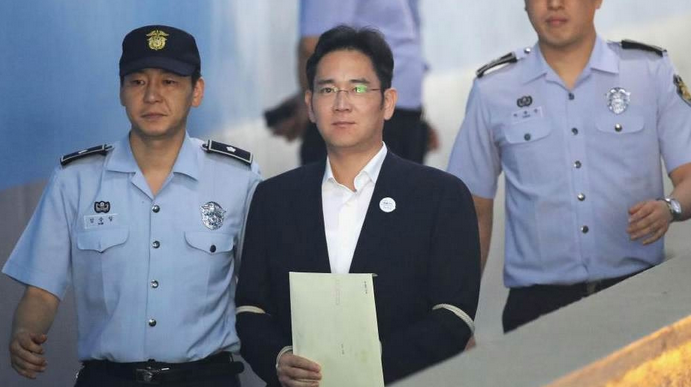 S. Korean prosecutors demand 12 years in prison for Samsung heir