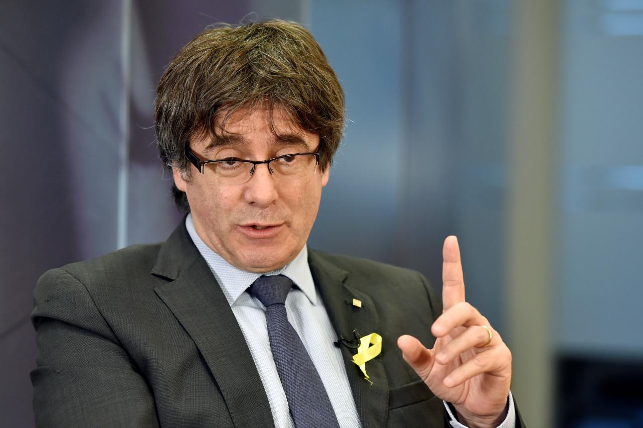 Let me come back, Catalan leader tells Spain