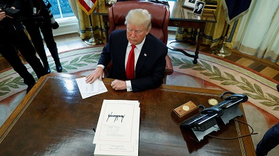Donald Trump signs US$1.5 trillion tax reform bill into law