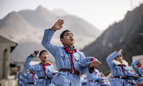 Red Army primary schools across China continue to carry the flag of patriotism