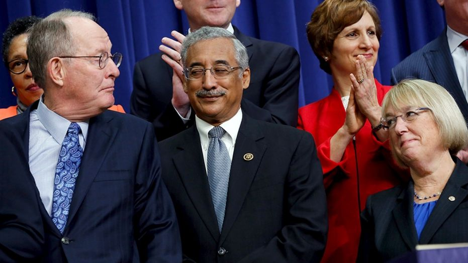Rep. Bobby Scott, D-Va., (center, in 2015) is accused of sexually harassing a former Congressional Black Caucus fellow.