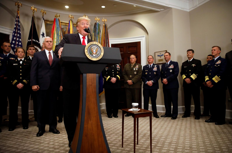 Trump signs defense policy bill, urges US Congress to fund it