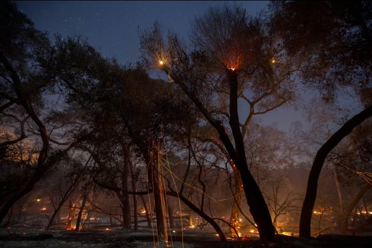 As winds relent, scorched California hopes for fire relief