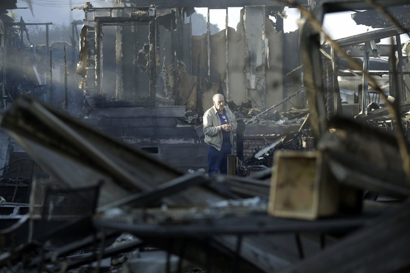 Fire engulfs California retirement areas, racehorse stables