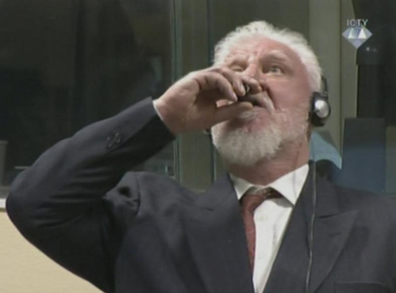 Bosnian war criminal dies after 'taking poison' in UN court
