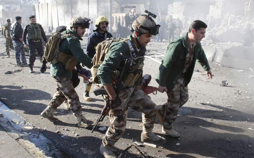 Suicide car bomb kills 21 in town north of Baghdad