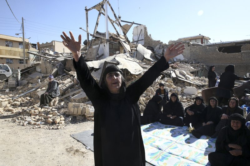 Iran to probe state-built homes destroyed by deadly quake